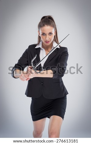 Beautiful woman in serious mood with a martial arts training sword. - stock photo