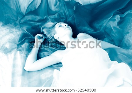 beautiful woman in silk - stock photo