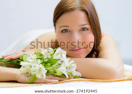 beautiful woman in spa salon - stock photo