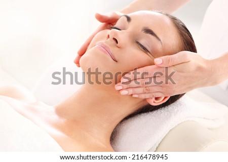 Beautiful woman in spa salon .Attractive brunette woman in spa salon. - stock photo