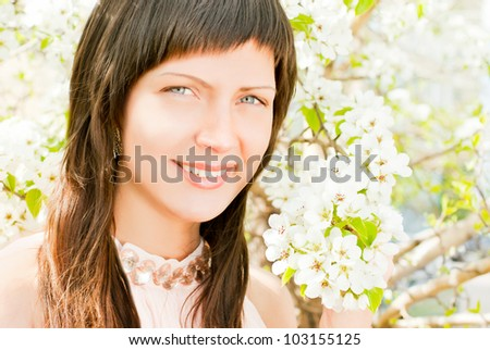 Beautiful woman in spring flowers