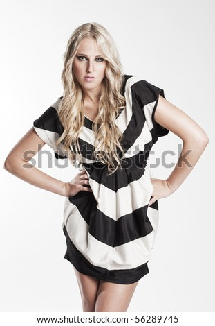 beautiful woman in striped dress - stock photo