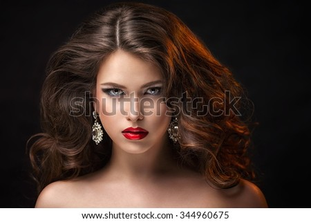 Beautiful woman in studio - stock photo