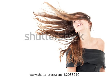 Beautiful woman in studio shot with wind on hair . - stock photo