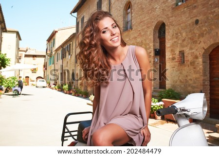 beautiful woman in summer dress  in Tuscany, Italy. - stock photo