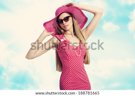 beautiful woman in sunglasses elegant dress and summer hat against blue sky  - stock photo