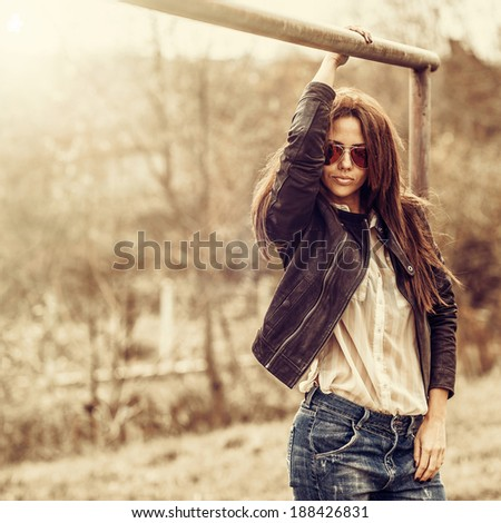 Beautiful woman in sunglasses - outdoor fashion partrait  - stock photo