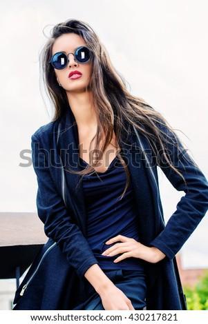 Beautiful woman in sunglasses over sky. Fashion style photo.  - stock photo