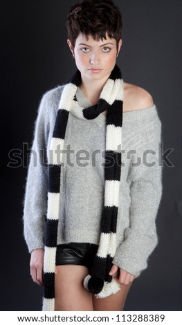 Beautiful Woman in Sweater and Scarf