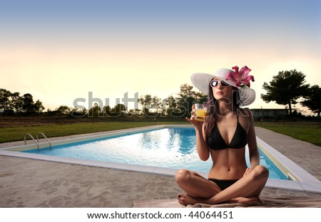beautiful woman in swimming pool - stock photo