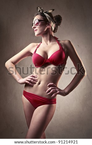 Beautiful woman in swimsuit - stock photo