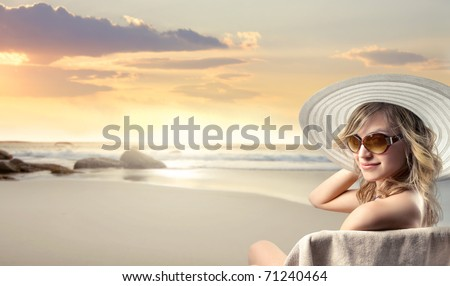Beautiful woman in swimsuit at the seaside - stock photo