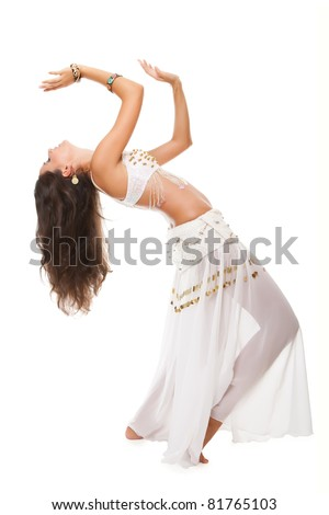 beautiful woman in the active arabic dance. studio shot. - stock photo