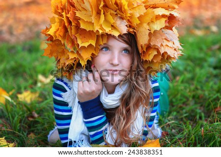 beautiful woman in the autumn wreath of maple yellow leaves.