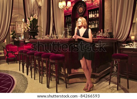 Beautiful woman in the bar of a luxury hotel