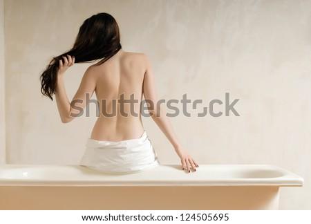 Beautiful woman in the bathroom - stock photo