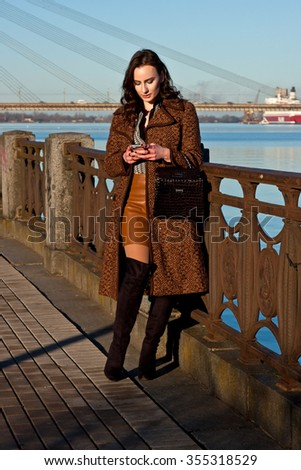 Beautiful woman in  the  city - stock photo