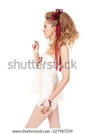 Beautiful woman in the doll style with red bow.Studio shot. Isolated nd white background. - stock photo