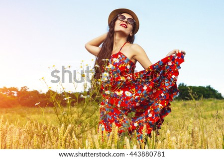 beautiful woman in the field.summer