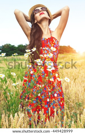 beautiful woman in the field.summer - stock photo