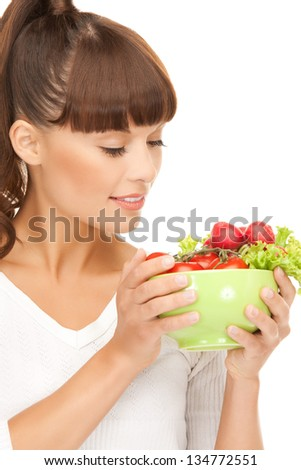 beautiful woman in the kitchen with tomatoes.. - stock photo