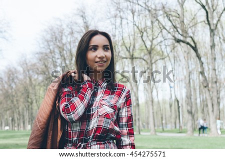 Beautiful woman in the park. Autumn photo.