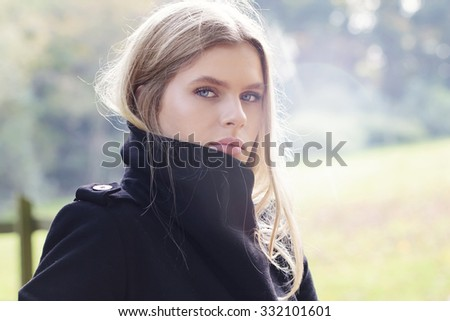 Beautiful woman in the park in autumn - stock photo