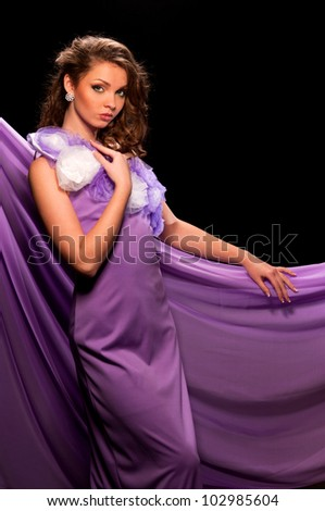 beautiful woman in the purple dress with a black background