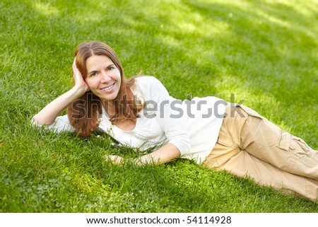 Beautiful woman in the summer park