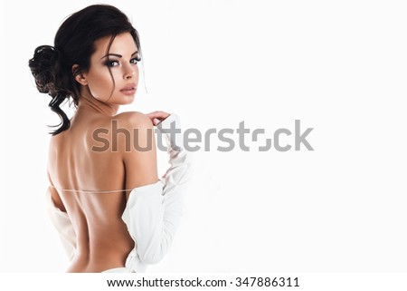 Beautiful woman in the white dress with naked back  - stock photo