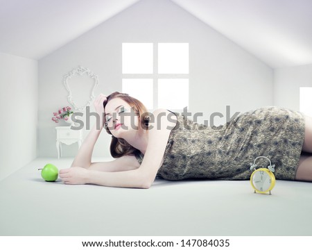 beautiful woman in the white toy house (photo compilation concept ) - stock photo