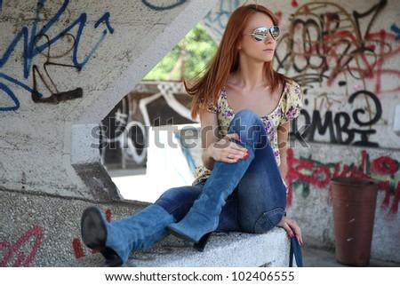 beautiful woman in urban setting - stock photo