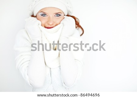 beautiful woman in warm clothing closeup portrait - stock photo