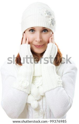 Beautiful woman in warm clothing on a white background.