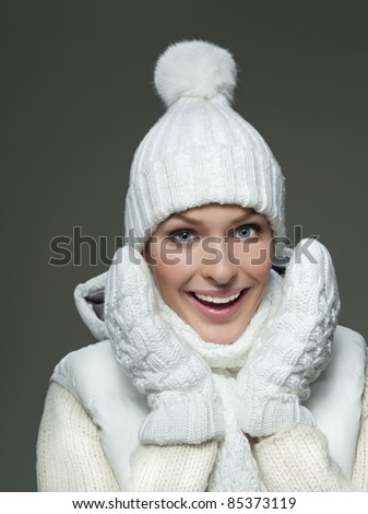 beautiful woman in warm clothing on dark background - stock photo