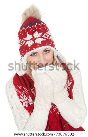 Beautiful woman in warm winter clothing. Isolated on white