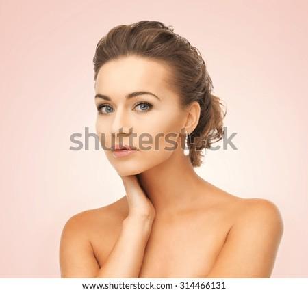 beautiful woman in white dress and diamond earrings - stock photo
