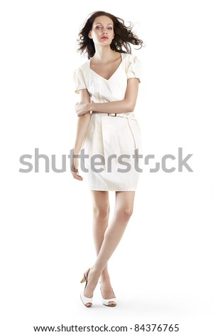 Beautiful woman in white dress on white - stock photo
