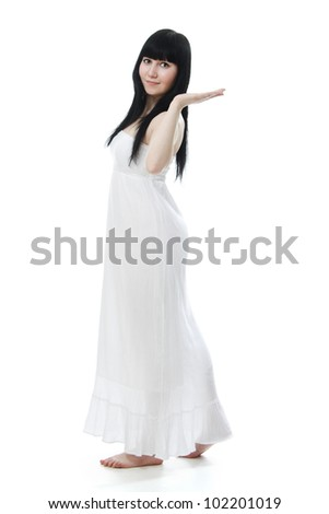 Beautiful woman in white dress on white background - stock photo