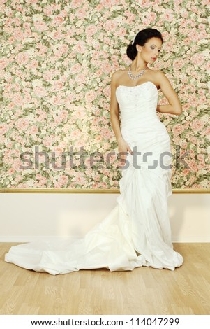 Beautiful woman in white evening gown, fashion portrait - stock photo