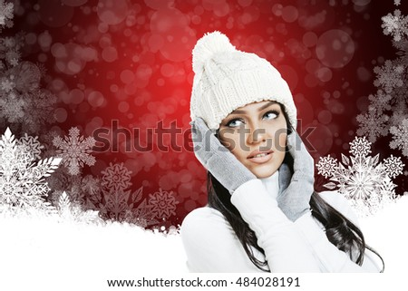 Beautiful woman in winter clothes on Christmas background