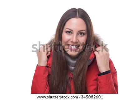 Beautiful woman in winter red jacket. Isolated on white background.