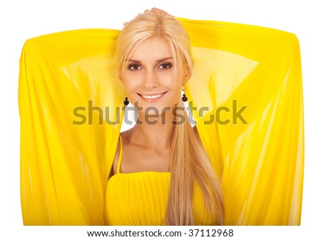 Beautiful woman in yellow dress has lifted hands and smiles, it is isolated on white background.