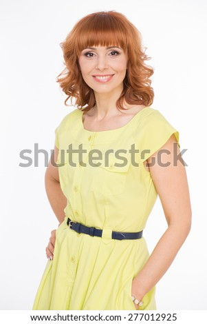 Beautiful woman in yellow dress on white - stock photo