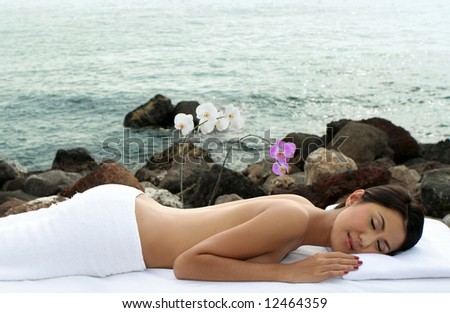 Beautiful woman indulging beauty treatment out in the nature - stock photo
