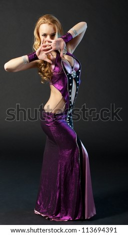 Beautiful woman is dancing the oriental dance