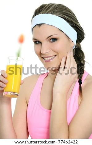 beautiful woman is drinking a fresh orange juice - stock photo