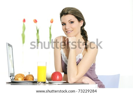 beautiful woman is having breakfaxt at home - stock photo