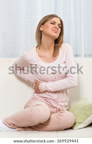 Beautiful woman is having pain in her back.Backache - stock photo