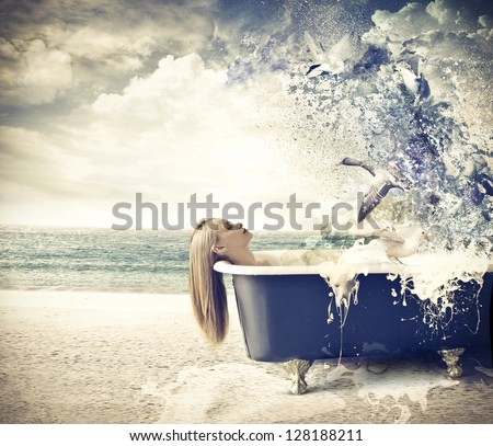 beautiful woman is relaxing in the tub at the beach - stock photo